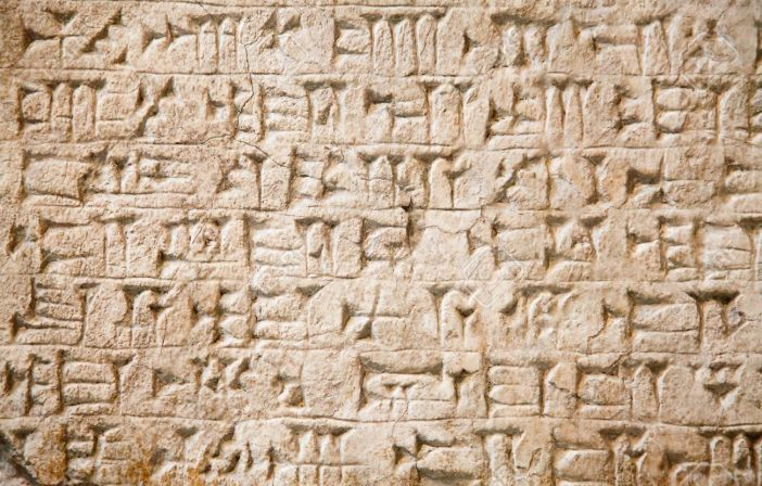 13926461-cuneiform-writing-of-the-ancient-sumerian-or-assyrian-civilization-in-iraq-stock-photo